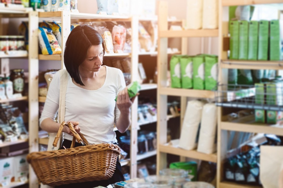 Woman reading product information on label