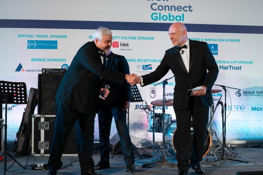 Gerardo Borromeo, PTC, accepts the Welfare & CSR Award from Stephen Miller, Mission to Seafarers, &  Mike Powell, Cardinal Point Maritime