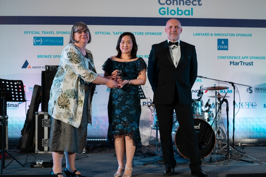 Ms Judy Chua, APL, accepts the Safety at Sea Award from Natalie Shaw, ICS, & Mike Powell, Cardinal Point Maritime