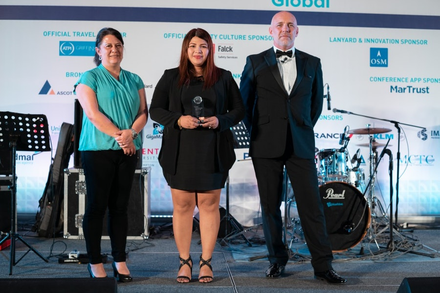 Nina Sue M De Silva receives Young Person of the Year Award from Jacqueline Smith, International Transport Workers' Federation, & Mike Powell, Cardinal Point Maritime