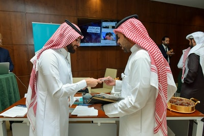 Exchanging Business Cards at Future Strategy Forum