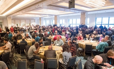 IT Dev Connections developers, IT pros, and DevOps networking during a training conference luncheon.