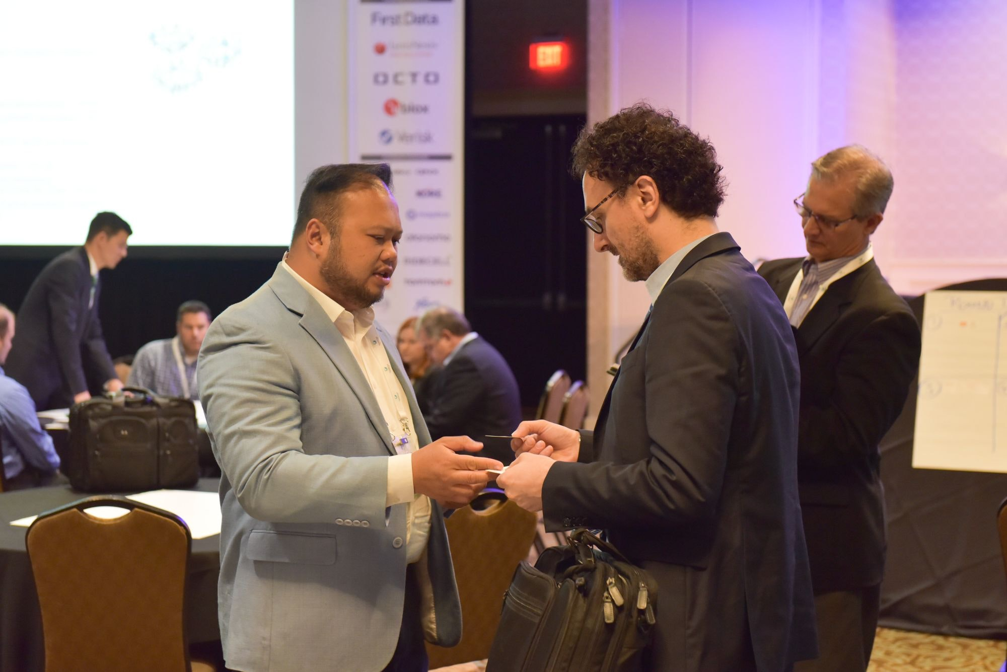 Automotive executives networking and swapping business cards