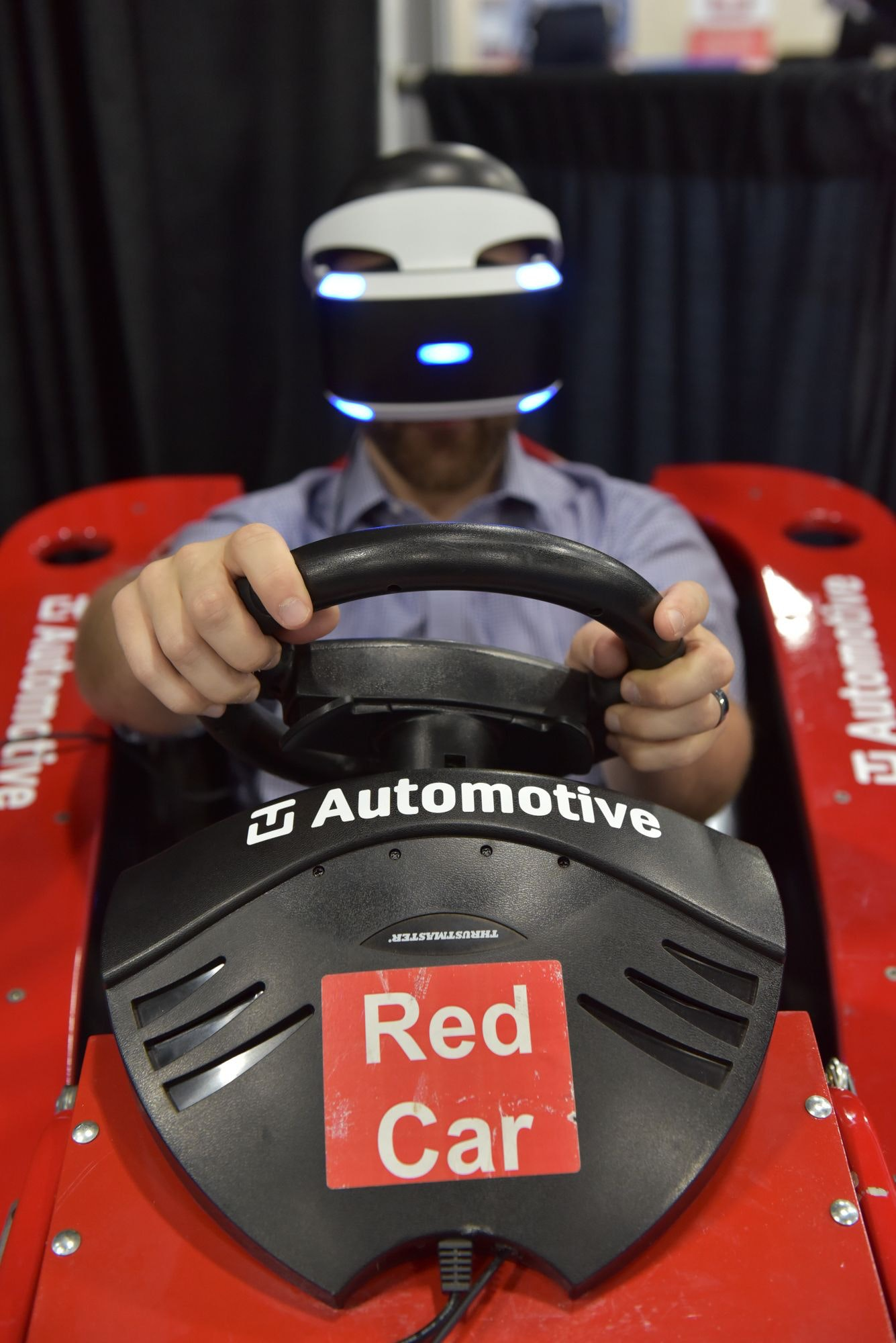 Future tech car with virtual reality headset on display in the expo