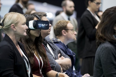 Girl in audience using VR headset